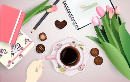 Cup of coffee and flowers, notepad, pencil candies