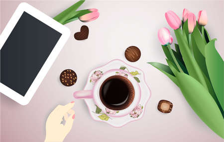 Cup of coffee, flowers and tablet chocolate candies