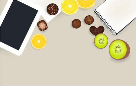 Laptop, kiwi lemon orange chocolate candies table