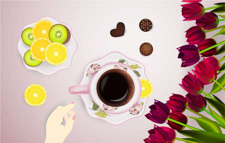 Cup of coffee and tulips, candies, table Фото со стока