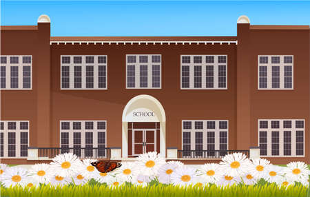 School building and empty front yard with green grass