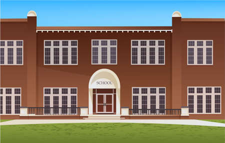 School building and empty front yard with grass