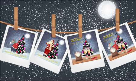 Polaroids with Christmas design on a Clothesline on a dark background with big moon and snow 写真素材