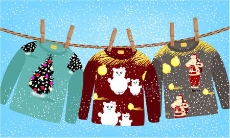 Cute, funny sweaters with Christmas design, clothes pegs on a Clothesline on a blue background with snow