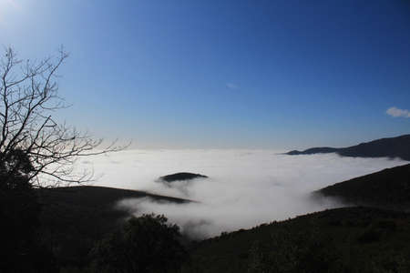 Morning view of foggy and cloudy mountain valley landscape