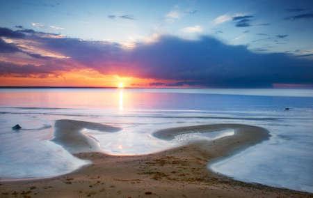 Romantic sunset at the beach