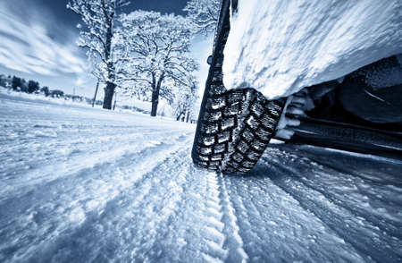 winter tires: Car tires on winter road