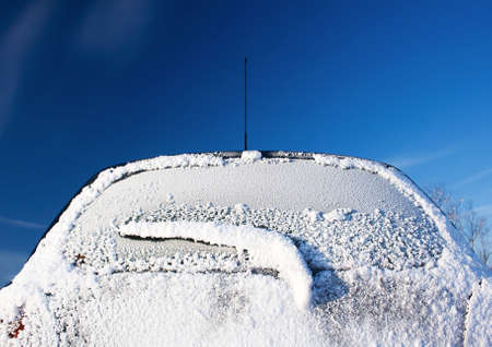 Rear car window covered with ice photo