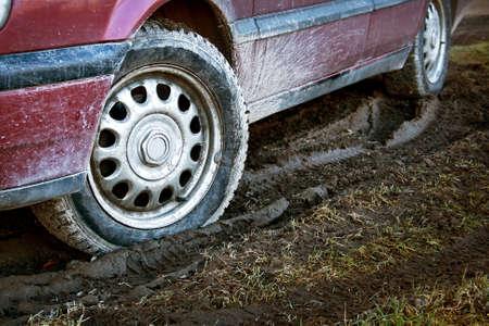 car tires in dirt photo