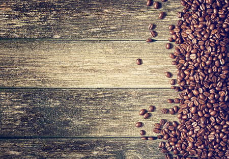 coffee sack: coffee on wooden background Stock Photo