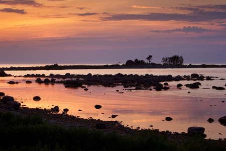 Seacoast at sunset photo