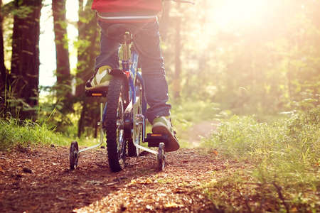 country boy: Boy on bike in the forest