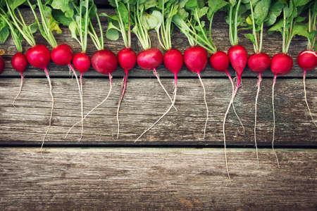 raw vegetables: Radish on wooden background