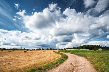 Countryside road with dramatic sky photo