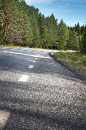 dividing lines: Asphalt road and dividing lines Stock Photo