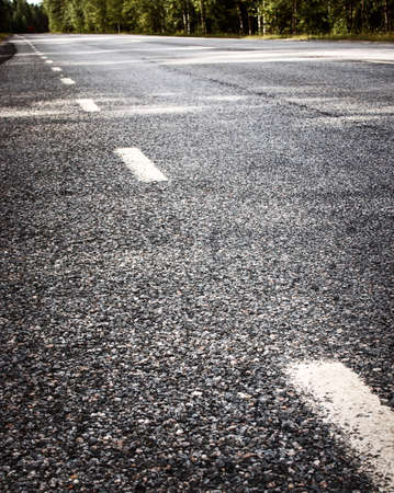 space weather tire: Asphalt road and dividing lines Stock Photo