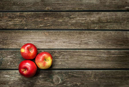 harvest background: Apples on wooden background