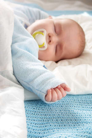 four month: Four month old baby sleeping on blue blanket