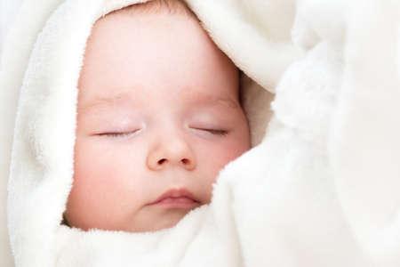 white blanket: little boy sleeping on soft white blanket