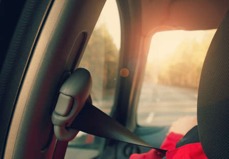 back roads: seatbelt in rear view to the windscreen and road