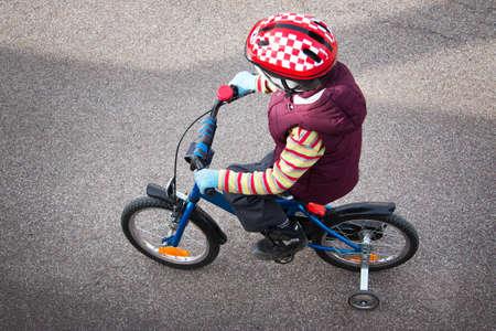 bike helmet: Boy on bike at asphalt road in spring