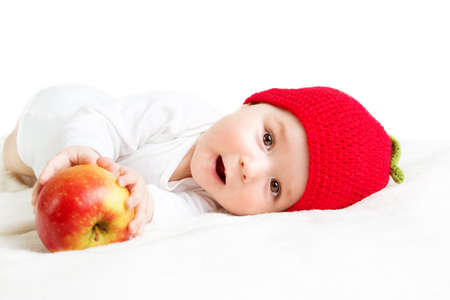 6 month old: 7 month old baby in apple hat Stock Photo