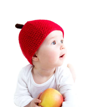 month: 7 month old baby in apple hat Stock Photo