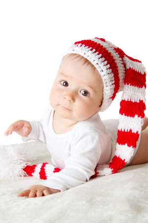 red hat: little baby in knitted red whitey hat on red blanket Stock Photo