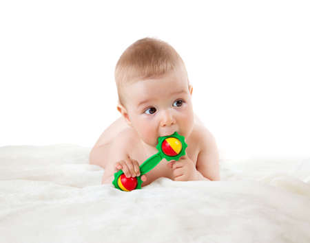 Baby holding a toy isolated on white background