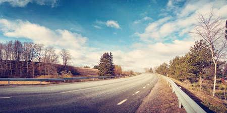 black asphalt road on sunny spring day