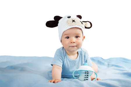 beautiful cow: cute baby in a cow hat drinking milk