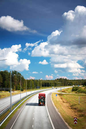 transport truck: a container truck moving on highway on sunny dat