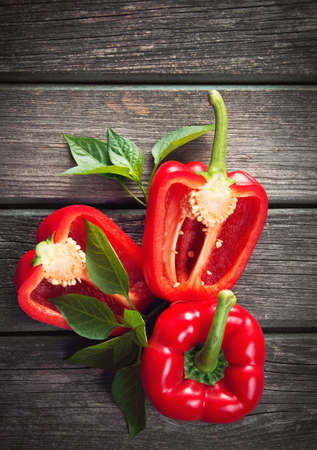 nutricion: Fresh sweet red pepper on old wooden background