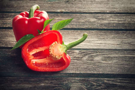 bell pepper: Fresh sweet red pepper on old wooden background