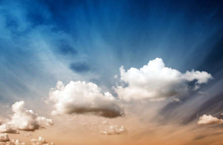 fluffy: Fluffy clouds on the blue sky on sunny day