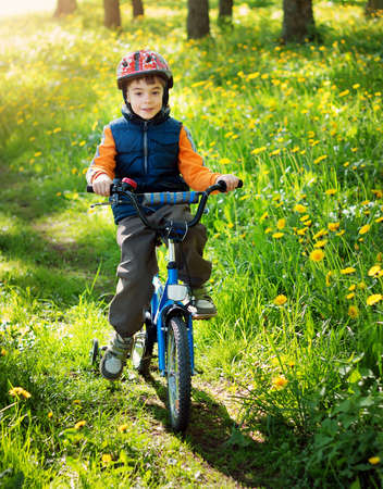 background summer: bike in the park with dandelions in pleasant sunny spring day Stock Photo