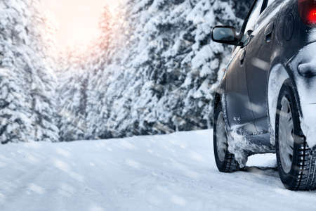 winter tires: car on winter road in the morning Stock Photo