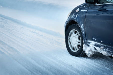 drifting ice: Closeup of car tires in winter on the road covered with snow Stock Photo
