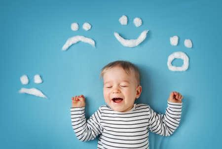 blue blanket: happy little boy on blue blanket background Stock Photo