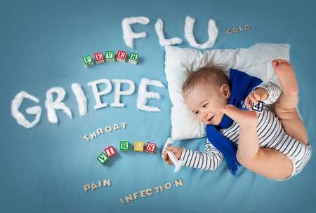 Garçon malade couché dans son lit. bébé avec le texte de grippe Banque d'images - 53077185