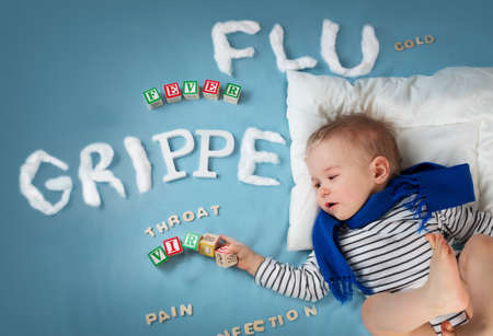 grippe: Ill boy lying in bed. baby with grippe text