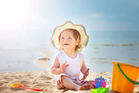 one year old: one year old girl shouting at the sea with bucket