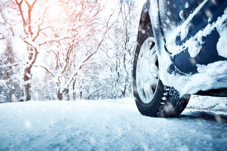 drive car: Car tires on winter road covered with snow. Vehicle on snowy alley in the morning at snowfall