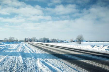 scenic drive: Asphalt road in snowy winter on beautiful frosty sunny day Stock Photo