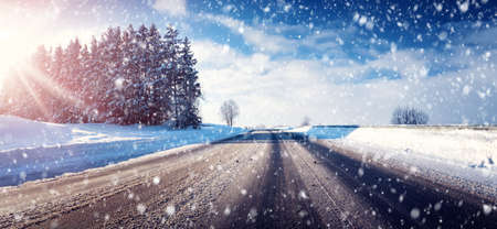 road conditions: Car on winter road covered with snow