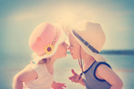 babyboy: Babygirl and babyboy kissing on the beach in straw hats