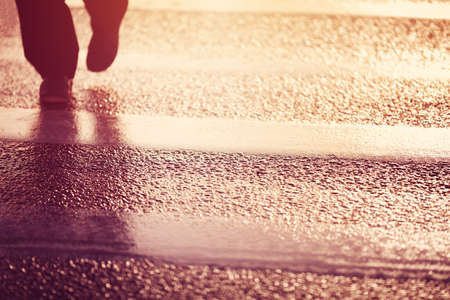 crossing street: Person silhouette walking on the pedestrian way
