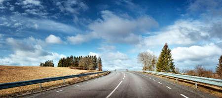black asphalt road on sunny spring da