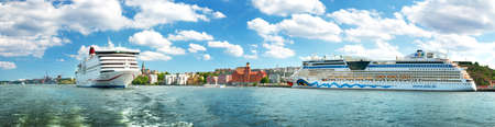 STOCKHOLM, SWEDEN - JUNE 25: View to Stockholm from seaside on June 25, 2016 in Sweden. Two ferries are at bay near stockholm on beautiful sunny day.