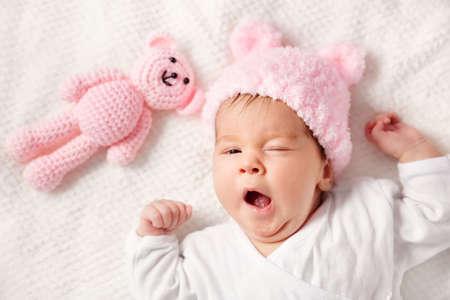 Cute newborn baby girl lying in the bed Archivio Fotografico